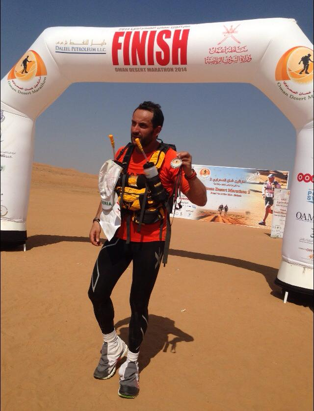 At the finish line of the Oman Desert Marathon